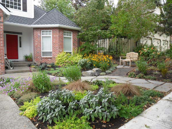 Creative garden layout maximizes the usability of a small yard while creating curb appeal. A new path provides a garden experience to the front door. Hardscape by Pete Wilson Stoneworks, Soil & Planting by J. Walter Landscape & Irrigation Contractor.