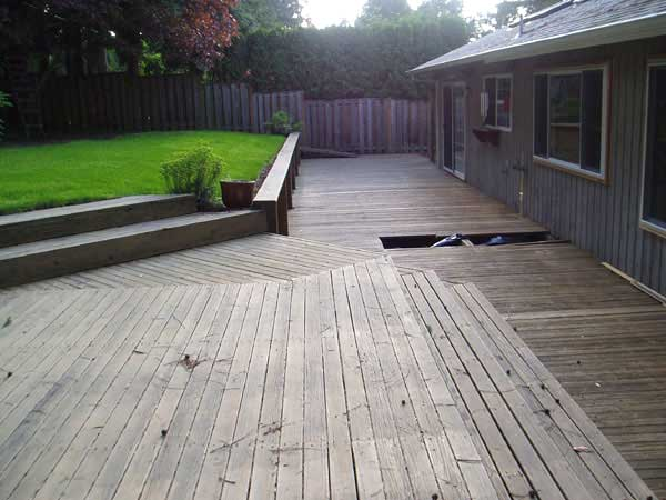 An extensive and rotting deck complete with mosquito breeding ground below was what this site had to offer.  Eliminating the wood and its upkeep was the big idea for this backyard.  A patio of concrete pavers and a rockery of boulders including stone slab steps to the upper lawn area made this backyard accessible and beautiful at the same time.  The clients went on a shopping trip with me to select the plants, and they installed the lawn and plantings themselves.  Stonework by Mountain Stone, Pavers by Escape Landscaping.